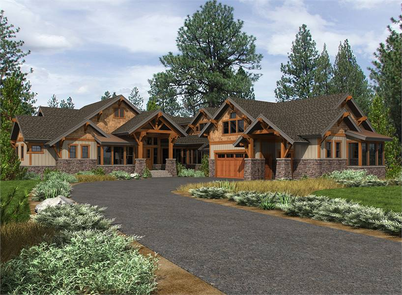 Front exterior view with multiple gables, vertical siding, tapered columns, and striking stone accents.