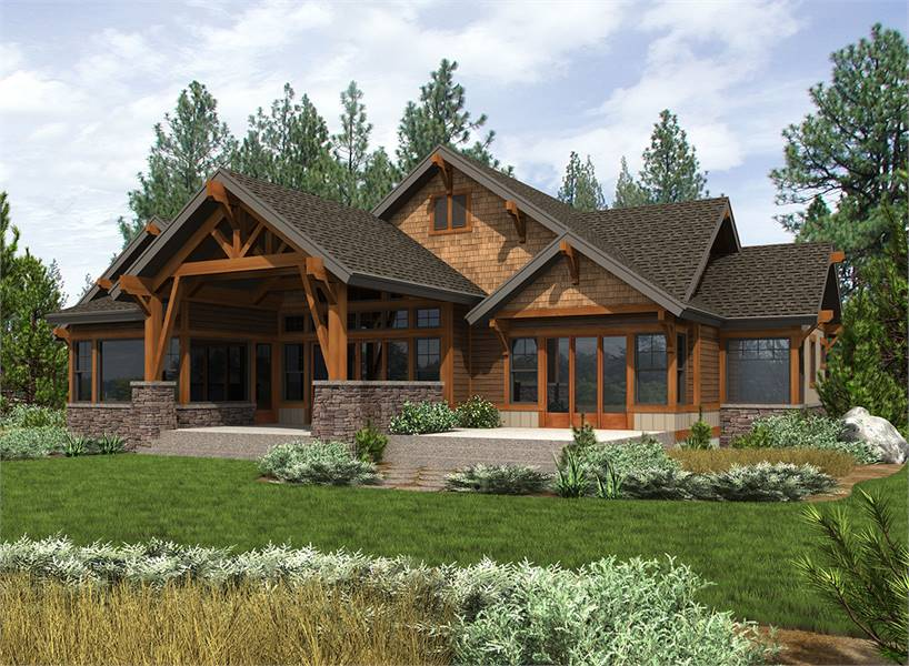 Rear exterior view with an open patio and a covered outdoor living framed with decorative wood trims.