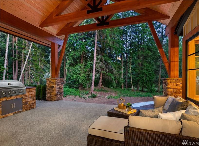 A summer kitchen across provides great outdoor entertaining.