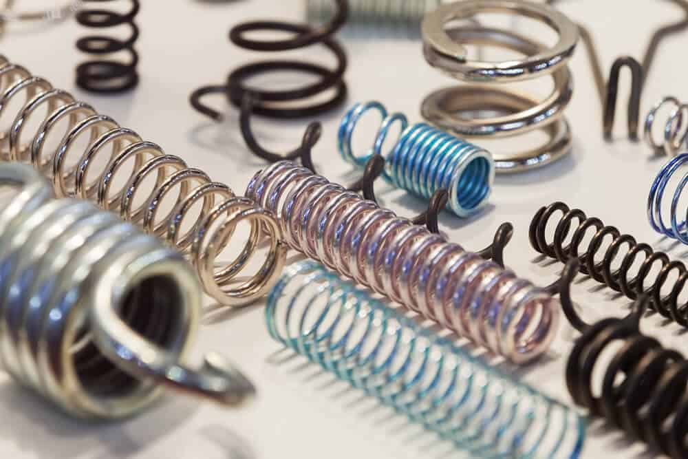 Springs of different types, colors and sizes.