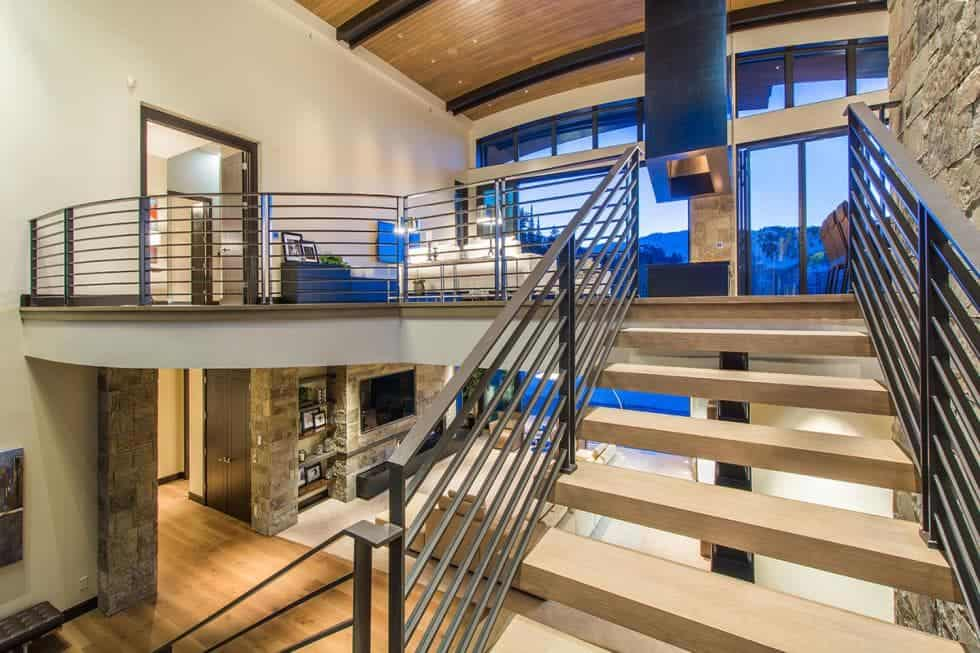 This is the view of the two levels from the vantage of the staircase. You can see here that both levels have glass walls that showcase the views outside. Image courtesy of Toptenrealestatedeals.com.