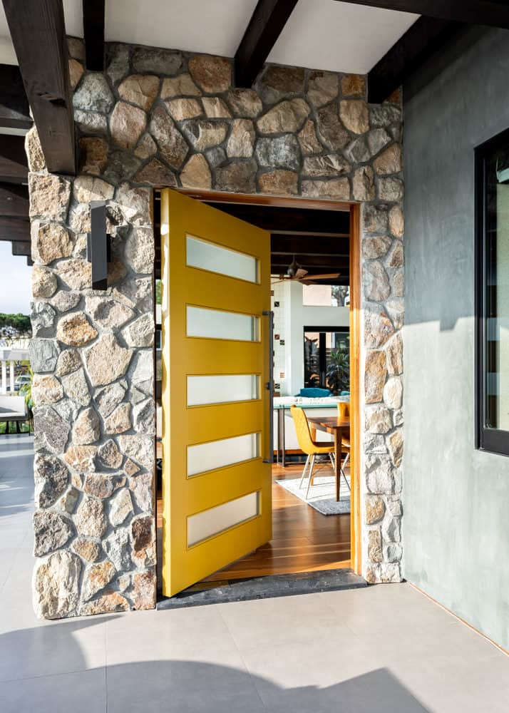Yellow wood and glass pivot front door