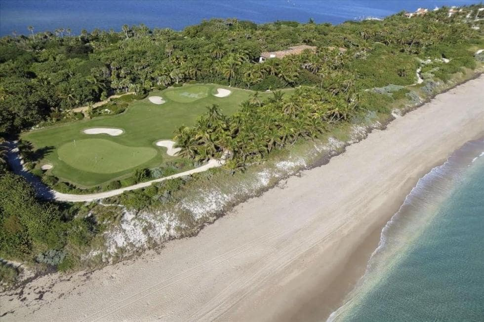 This is an aerial view of the golf course. You can also see here the cultured jungle and the main house at the oceanfront edge of the property. Image courtesy of Toptenrealestatedeals.com.
