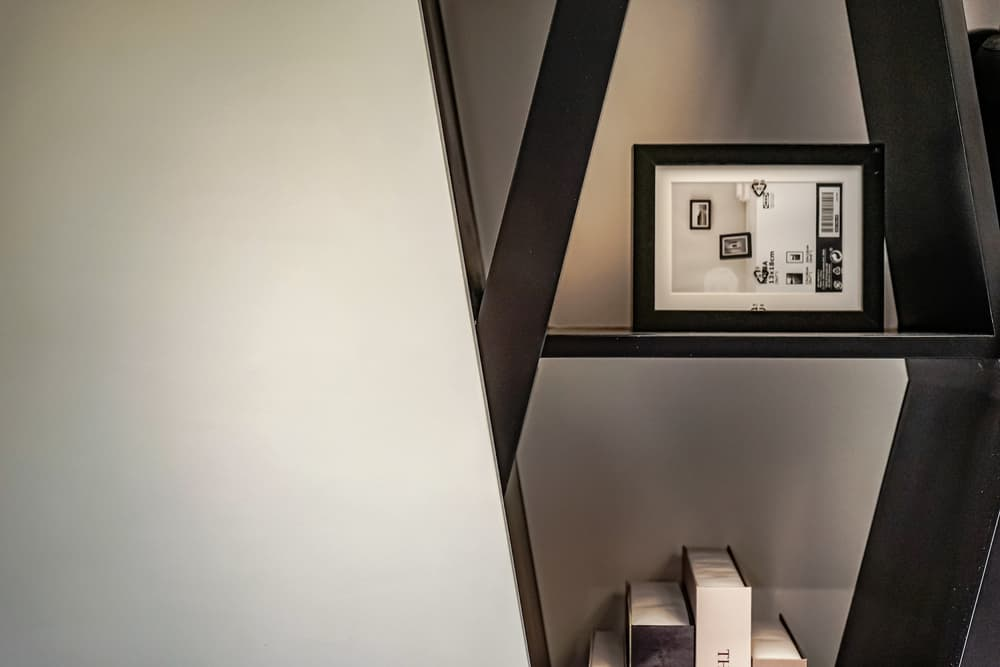 This is a close look at the built-in shelf of the living room with its contrasting materials and unique design.