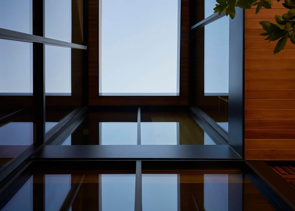 This is the skylight above the staircase that connects with the tall glass walls.
