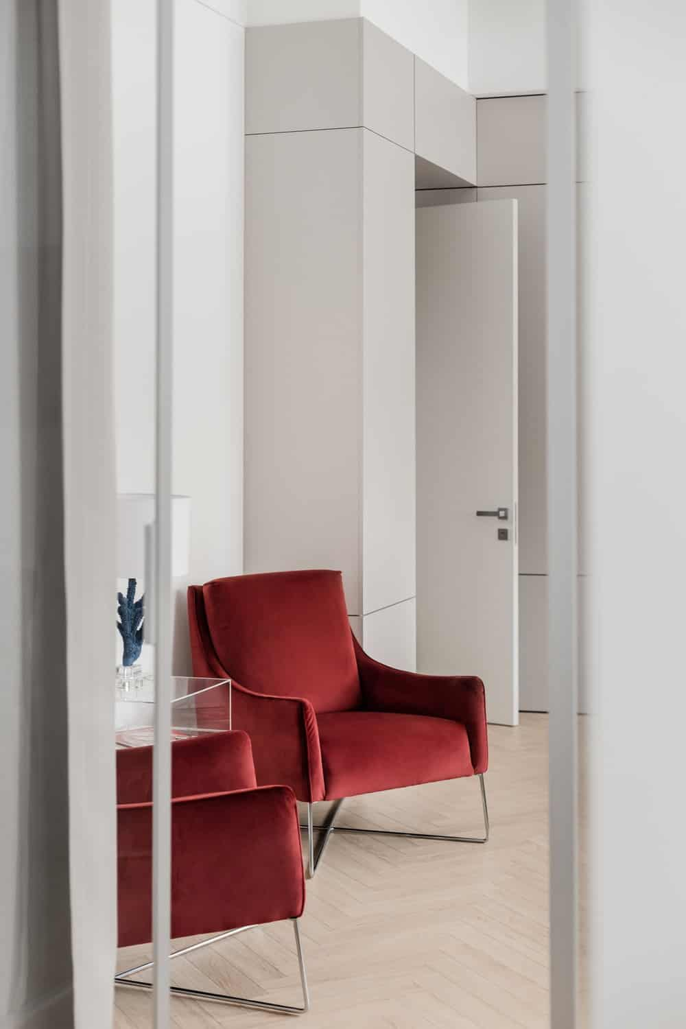 At the side of the office is a wall with a couple of comfortable cushioned chairs.