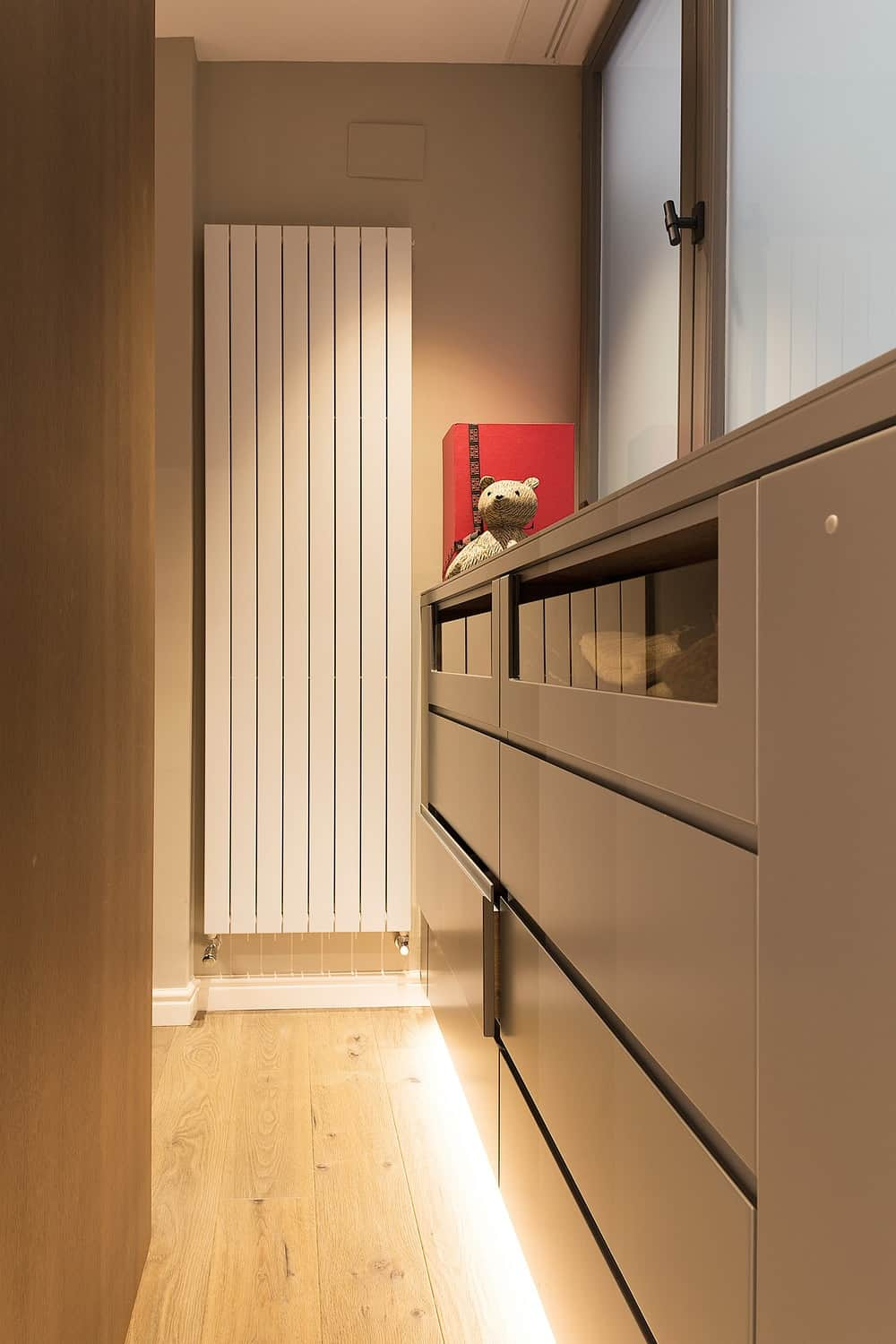 This is a close look at the set of drawers of the walk-in closet behind the bed.