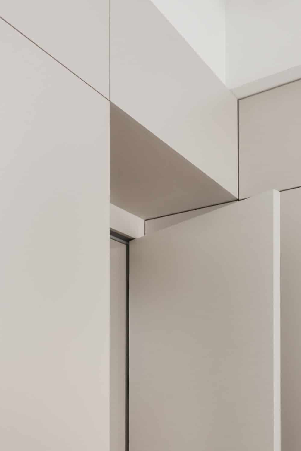 This is a close look at the white door, walls and ceiling of the conference room that blend perfectly.