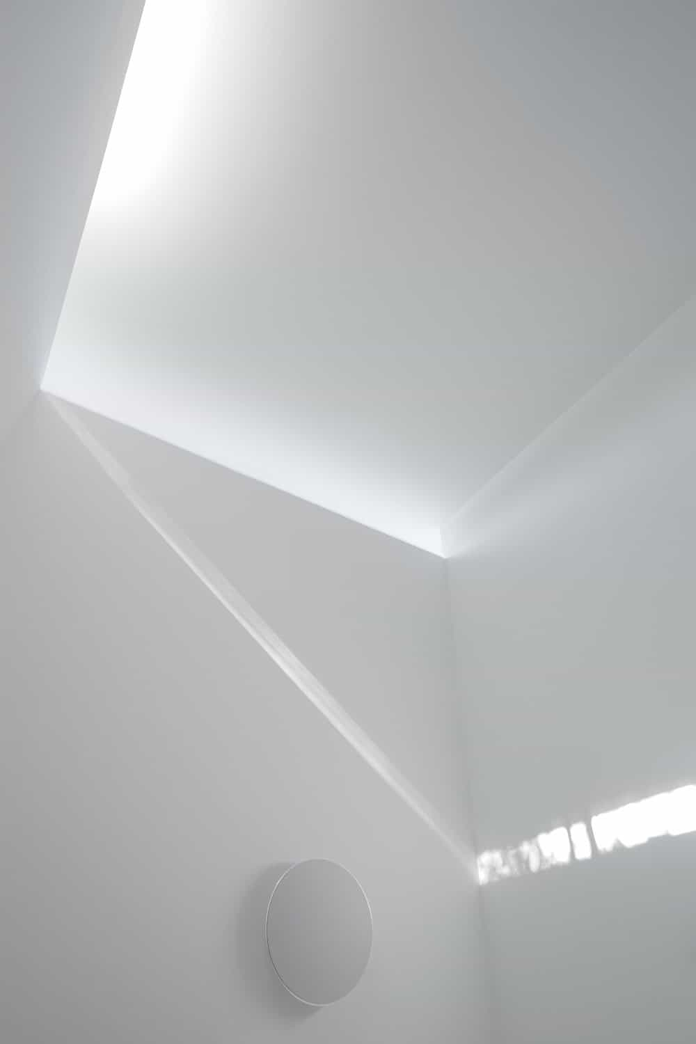 This is a view of the ceiling, its transom windows and the beam of light it produces.