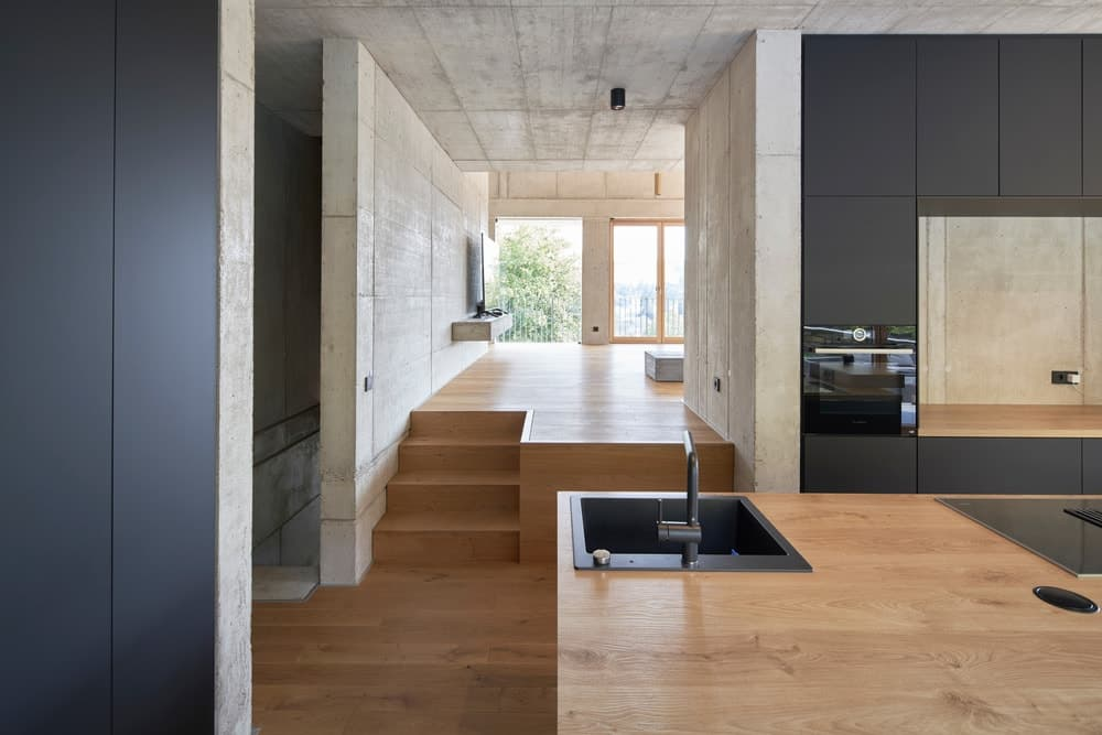 The landing can be viewed from the vantage of the kitchen island that has a sink area on its corner.
