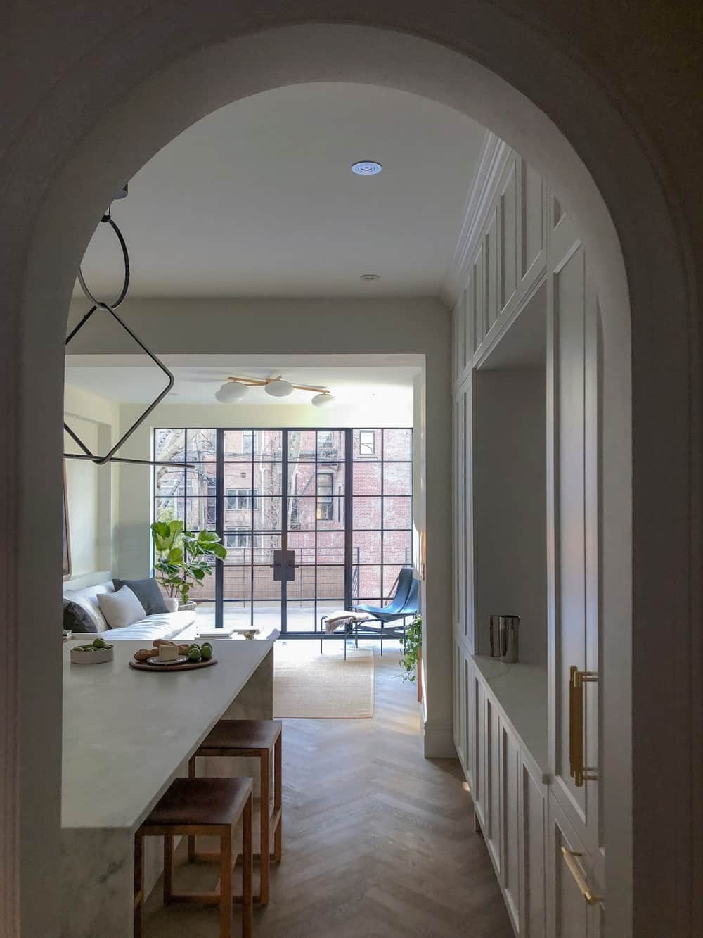 This is a view of the kitchen and living room from the vantage of the arched entryway.