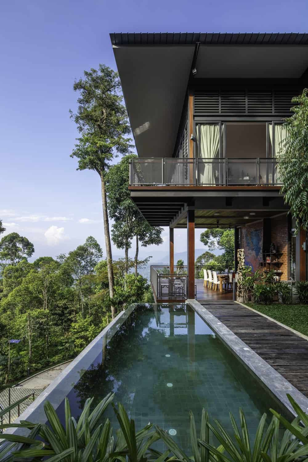 The infinity pool has a clear view of the balconies and the surrounding landscape.