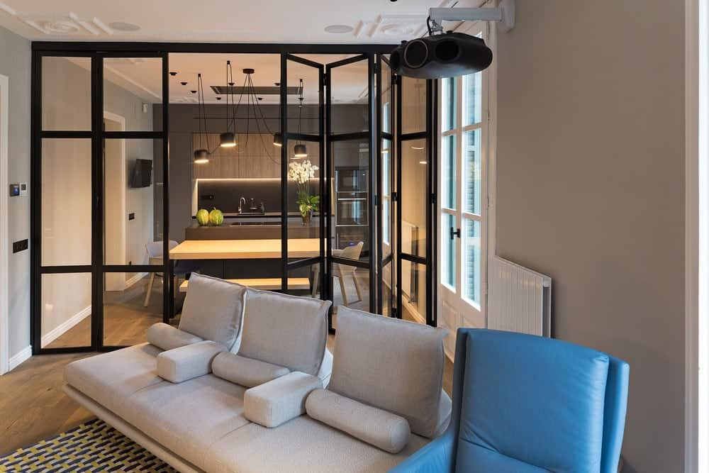 This view of the sofa also shows the glass walls that separate the living room from the dining area and kitchen.