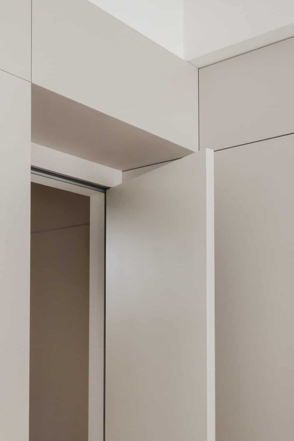 This is a close look at the door of the office with the same tone as the wall panels.