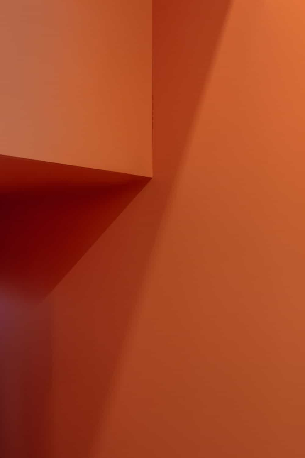 This is a close inspection of the orange entryway and its matte material.