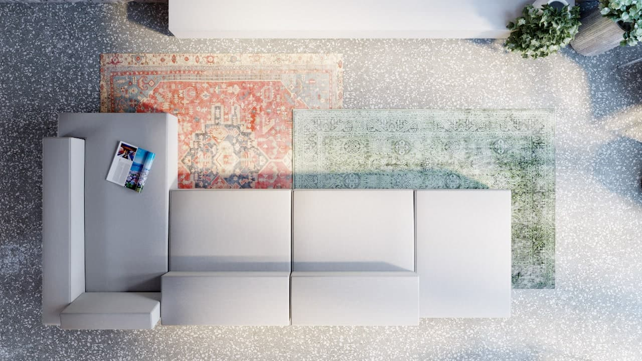 This is a top view of the large L-shaped sectional sofa adorned by the colorful area rugs underneath.