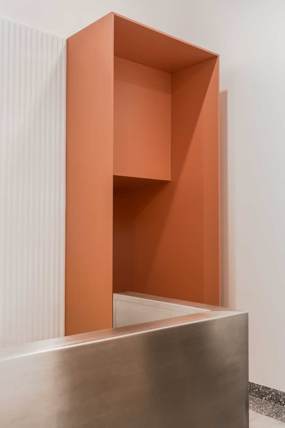 Here you can see the stainless steel railing wall that leads to the orange entryway of the staircase.
