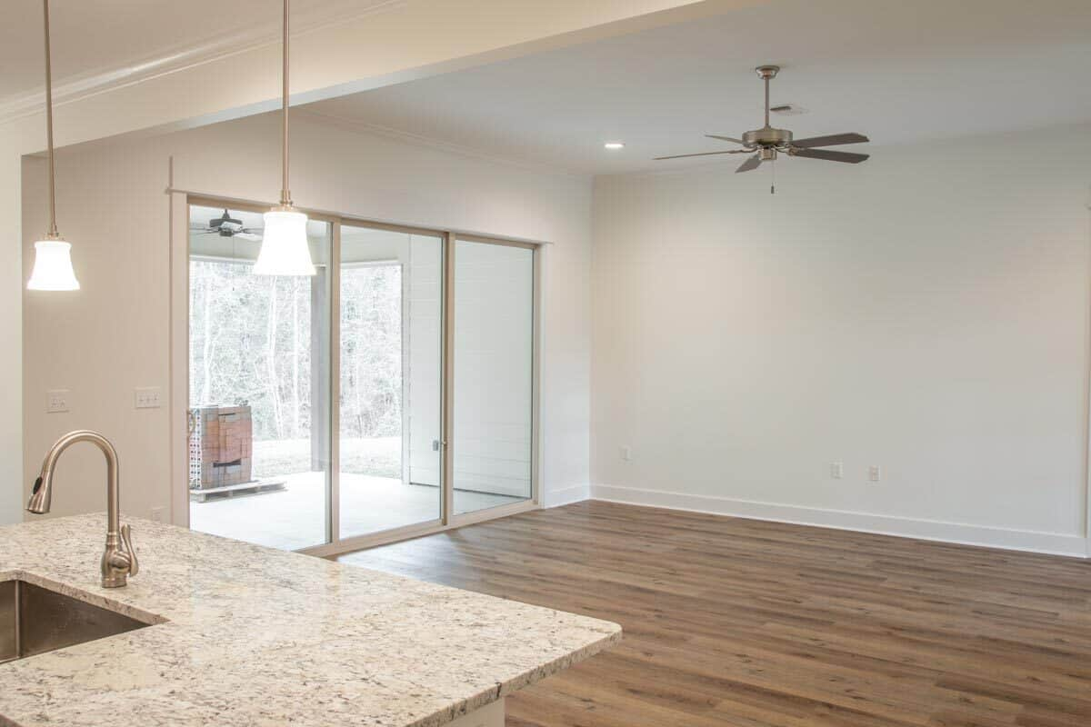 Across the kitchen is the living space with glass sliding doors that open to the back porch.