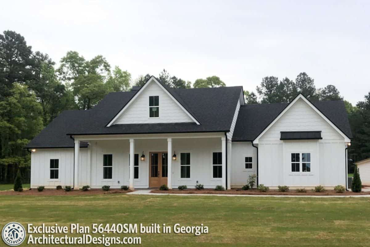 Black gable roofs create a stunning contrast to the white exterior of this house.