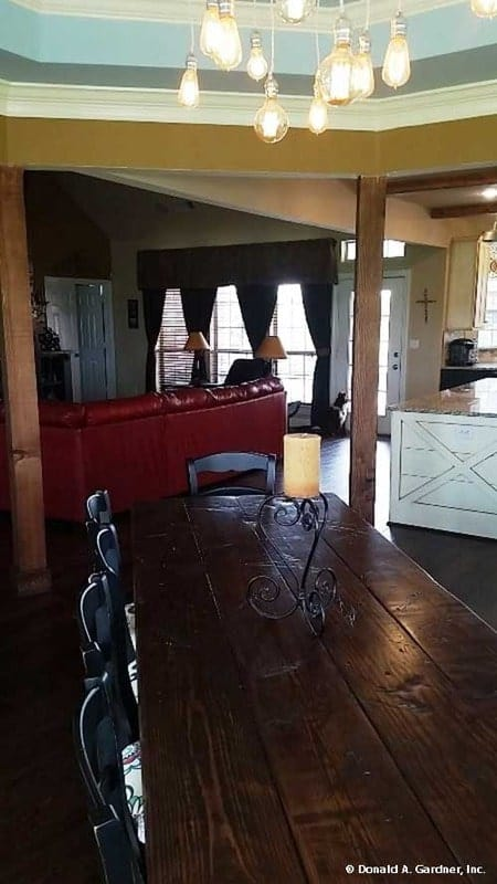 The dining area overlooks the living room and open kitchen.