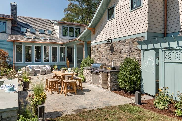 Back patio with a summer kitchen and outdoor dining.