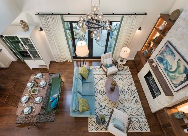 View of the shared living and dining room from the second-floor balcony.