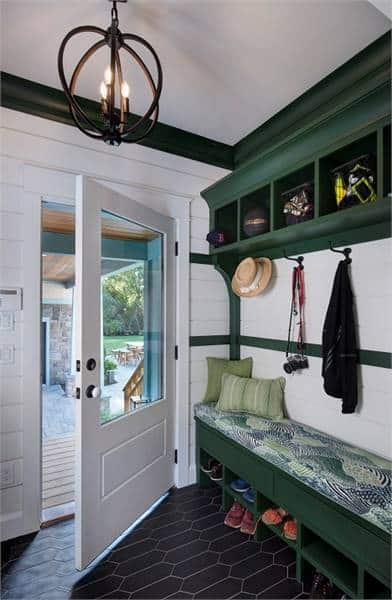 The opposite view shows the green shelves and cushioned bench with a shoe rack underneath.