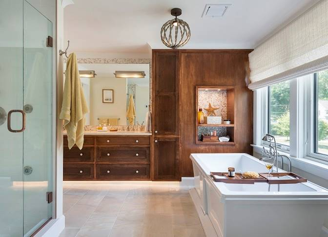 The primary bathroom is equipped with a walk-in shower, a deep soaking tub, and wooden vanity.