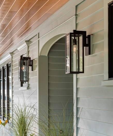 A closer look at the glass sconces flanking the arched doorway.