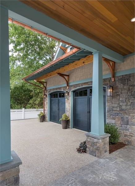 Breezeway framed with tapered columns connects the main home to the garage.