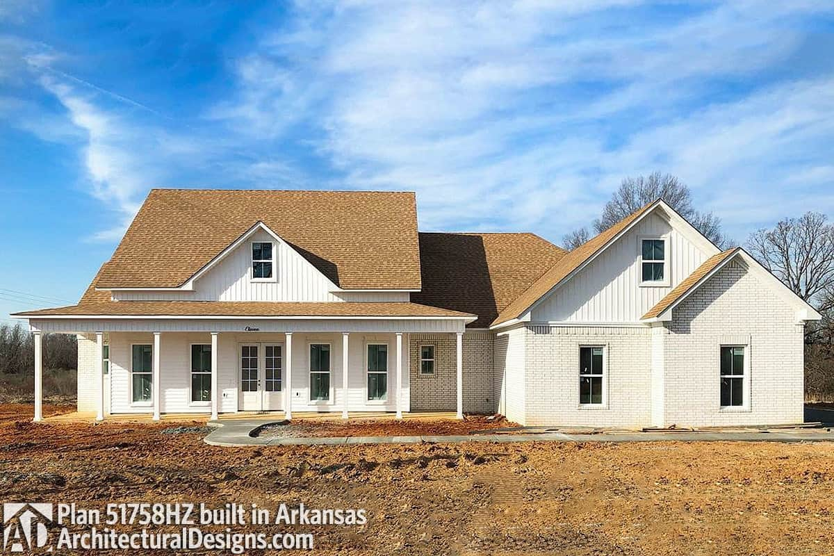 A combination of white brick and siding embellished the classic farmhouse.