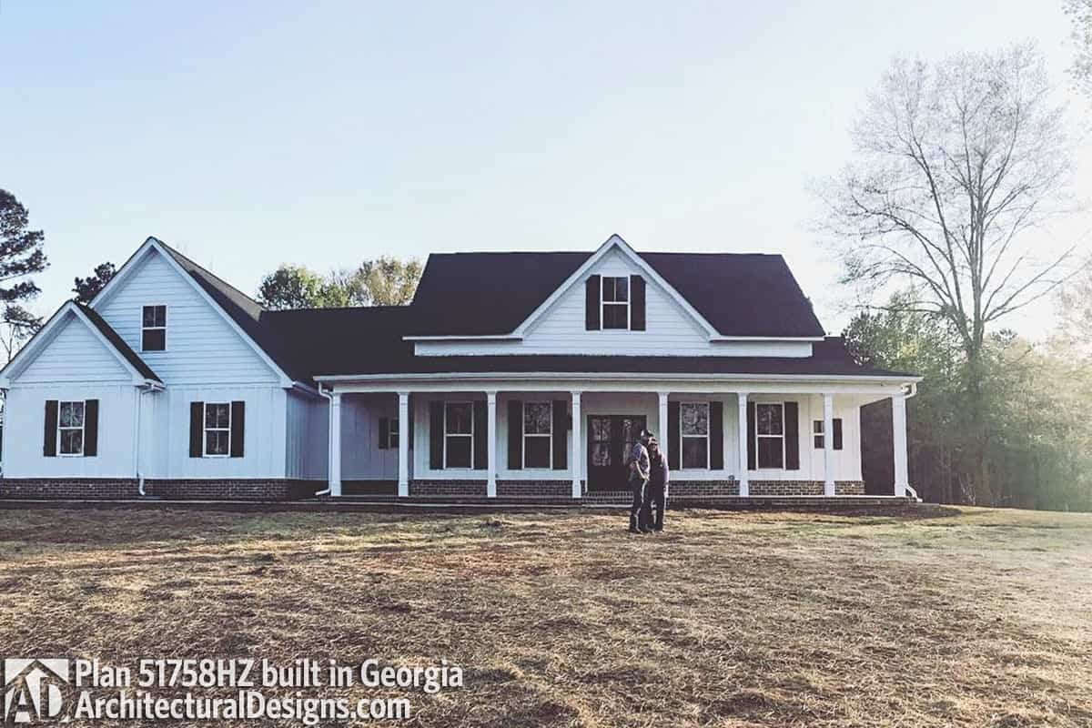 This house is a perfect blend to its surrounding boasting gable rooflines, white siding, and a wide covered porch.