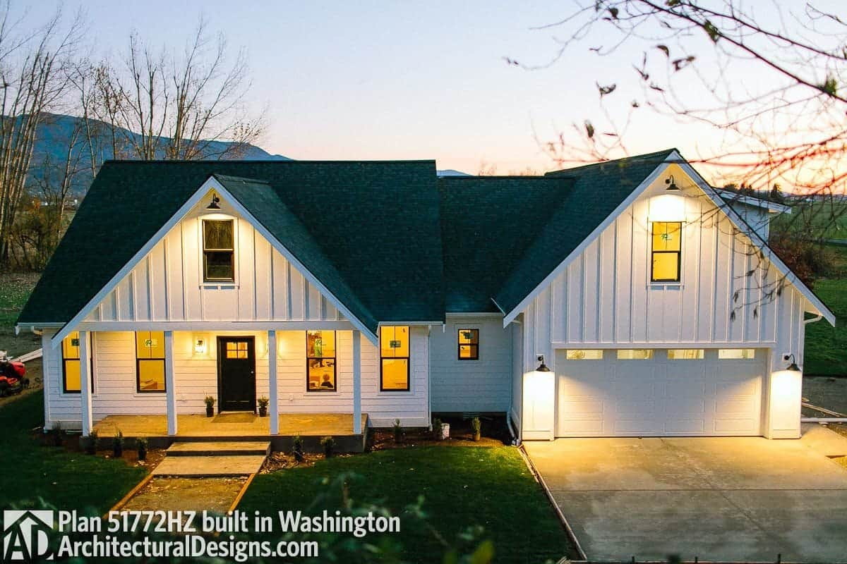 View of the home during sunset showcasing its warm glow that complements the white siding.