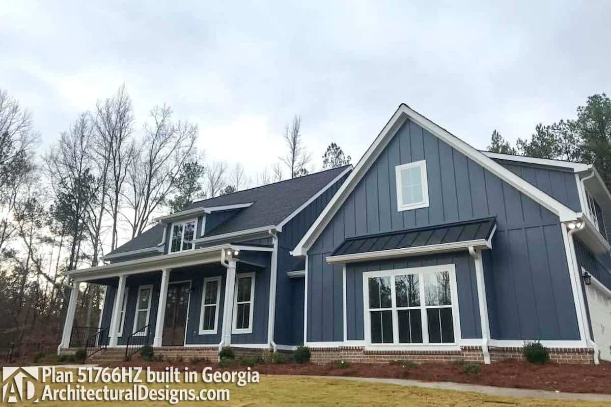 Alternate exterior featuring a blue board and batten siding accentuated with white framed windows and trims.