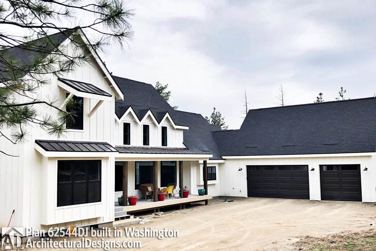 Tiled roofs and black aluminum framed windows contrast the board and batten siding of this house.
