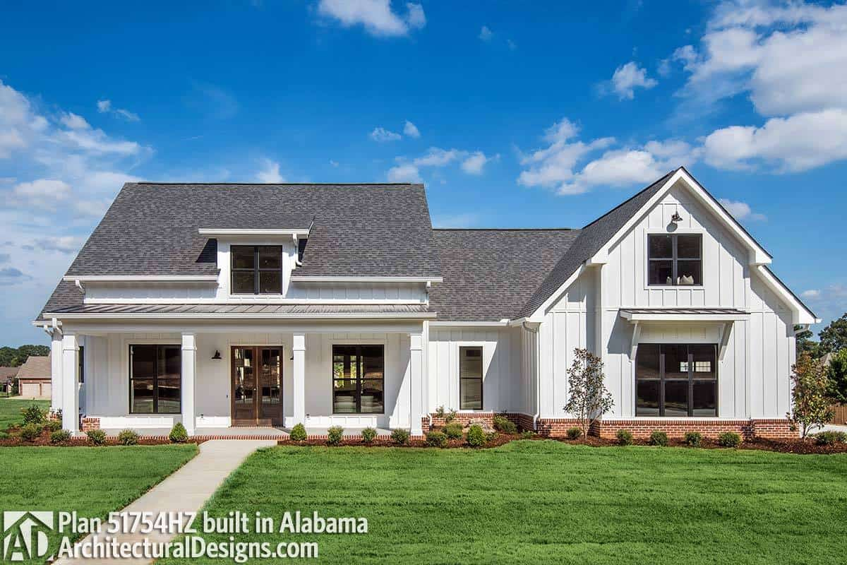 A front exterior alternative with brick bases and white columns.