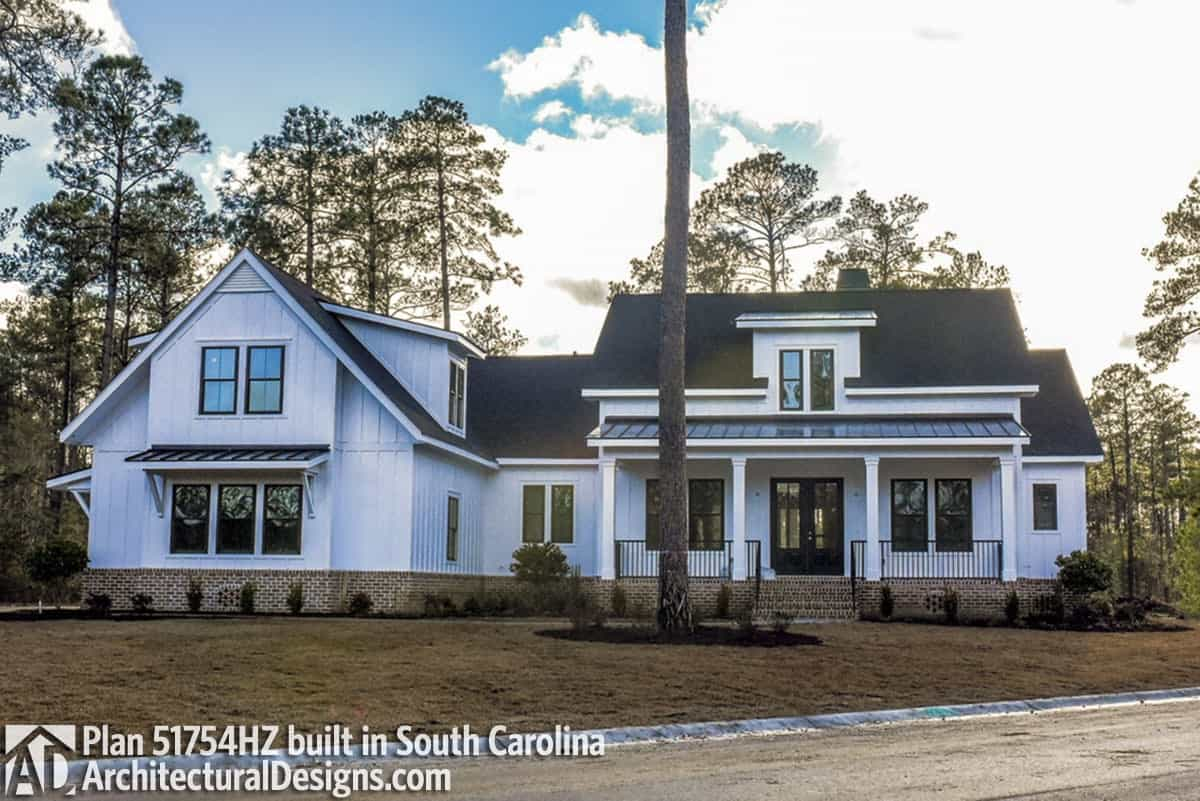 Same layout with the previous one. It also includes a shed dormer and wrought iron railings framing the front porch.