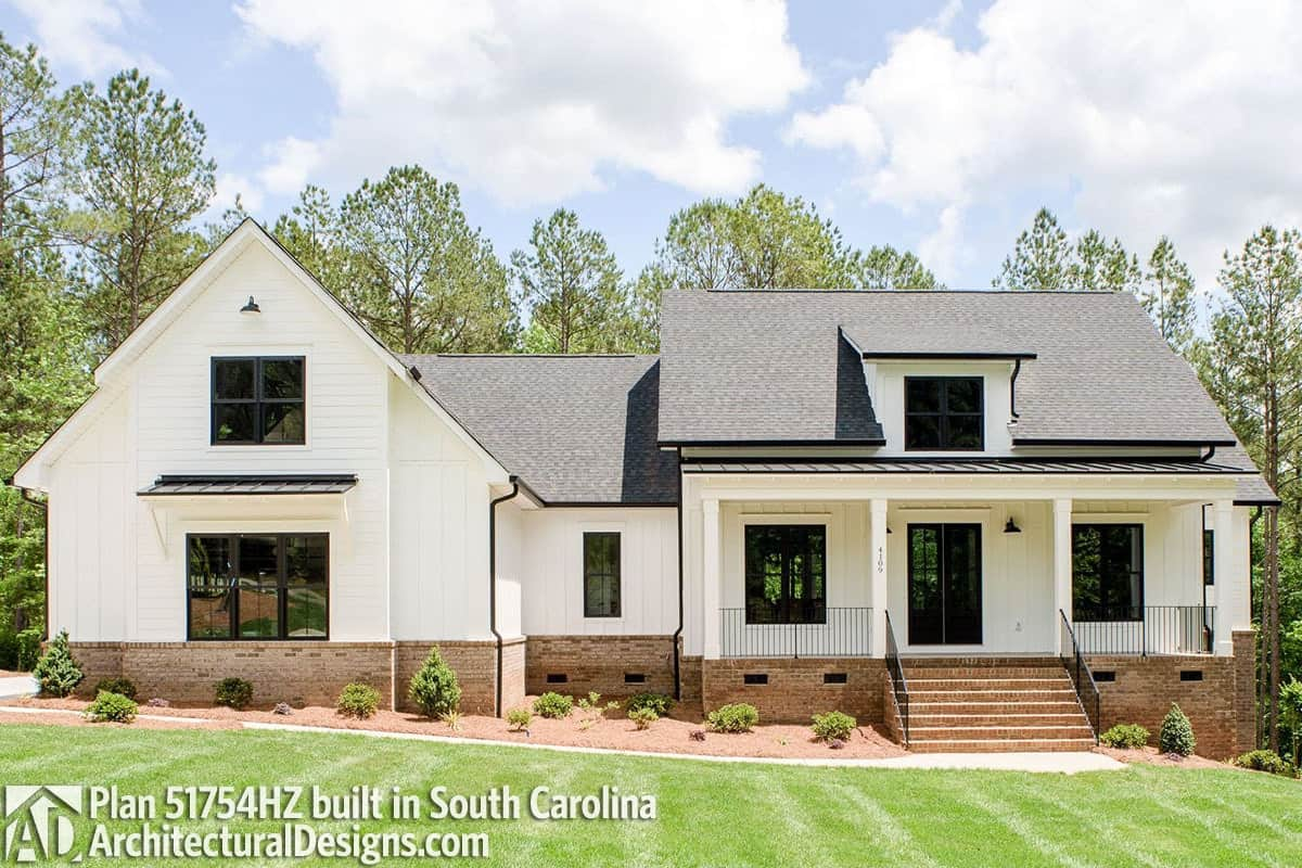 This alternative exterior is designed for sloping lots. It has a combination of brick and vertical siding, shed dormer, and a raised front porch.