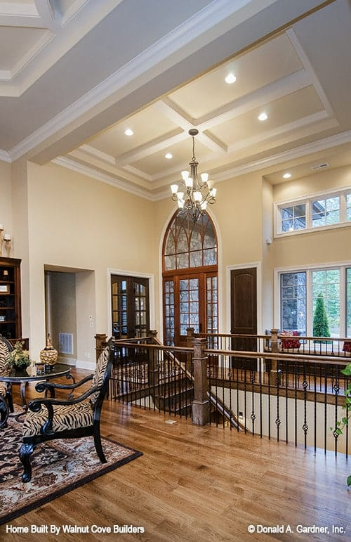 View of the foyer from the living room showing its coffered ceiling.
