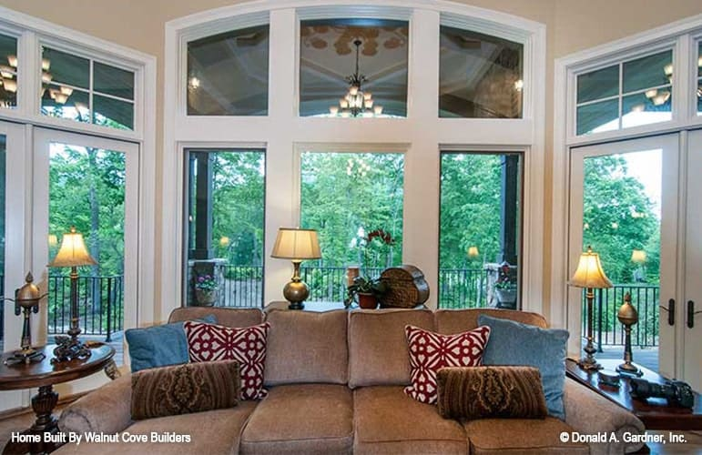 The living room has a great view of the back porch with its clerestory windows and french doors.