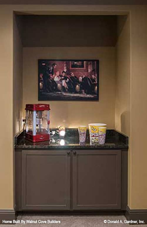 A closer look at the bar topped with a framed artwork.