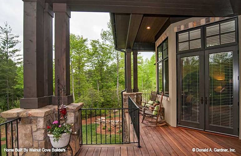 A french door leads to the back porch that's filled with wooden rocking chairs.