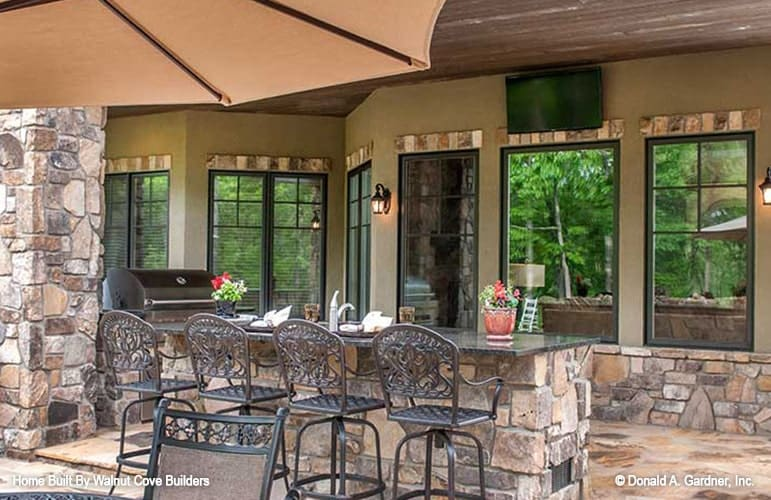 Lower level patio with outdoor dining and a summer kitchen.