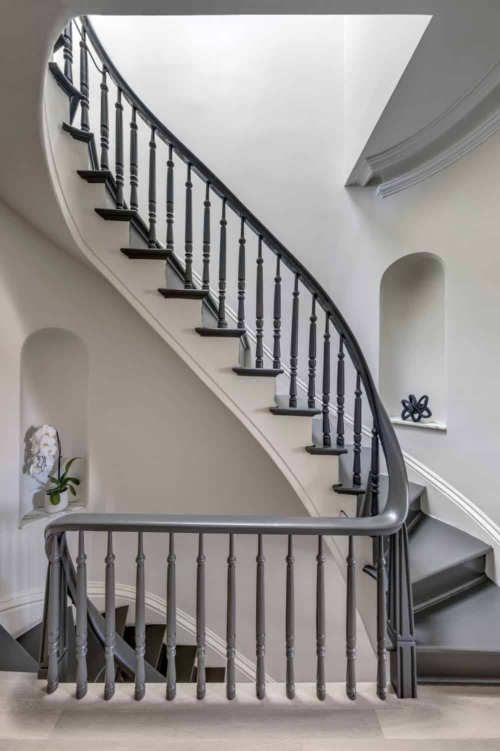 This is a look at the second-floor landing featuring the wrough-iron railings of the staircase.