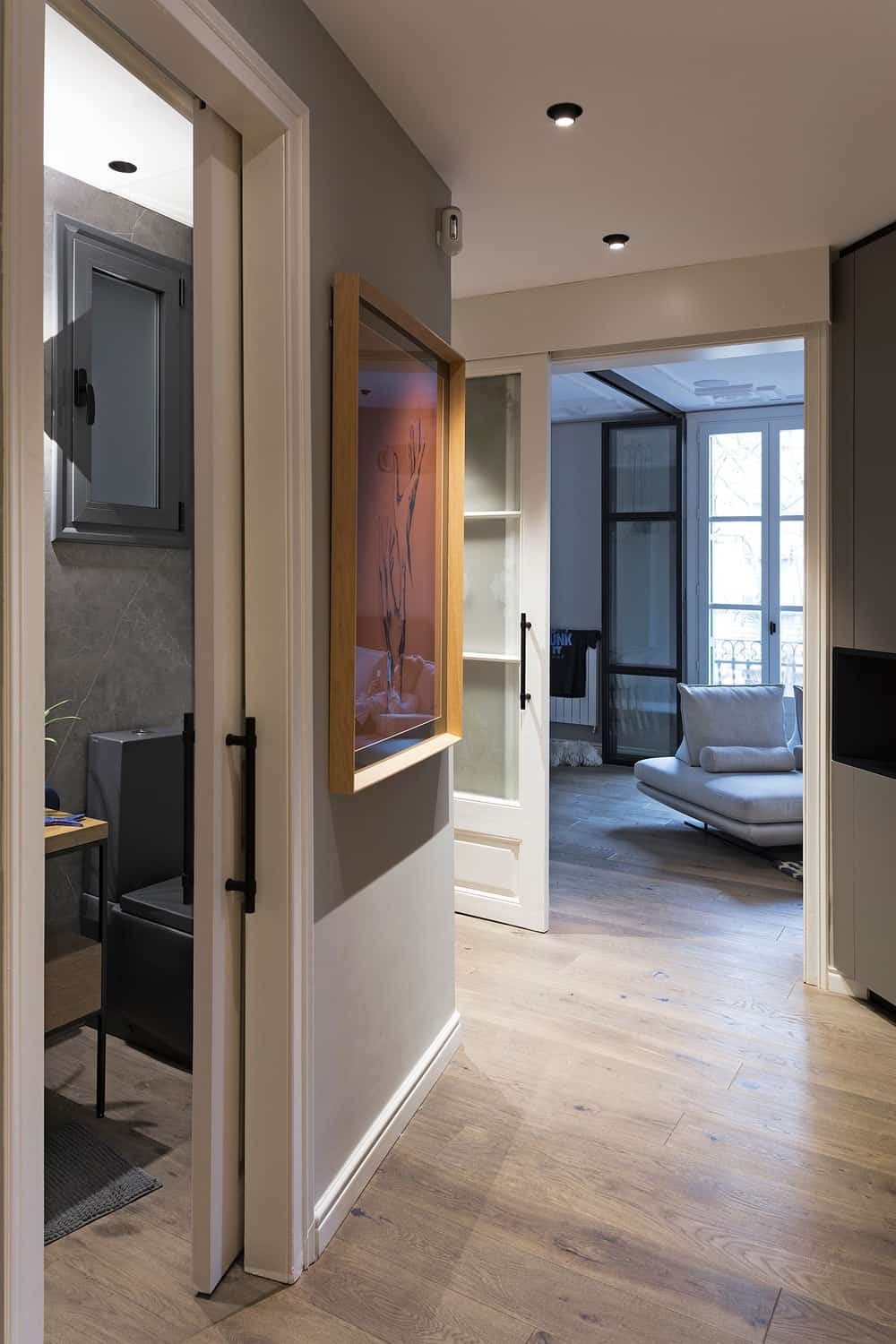 This view of the hallway showcases the proximity of the bathroom from the living room door.