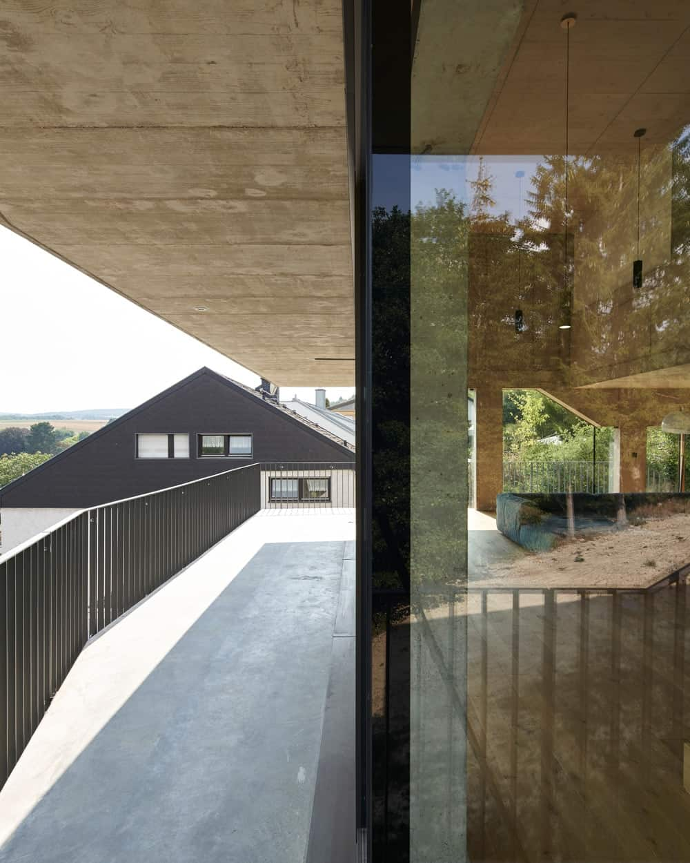 The glass walls give a glimpse of the interiors of the house and at the same time bring in natural lighting.