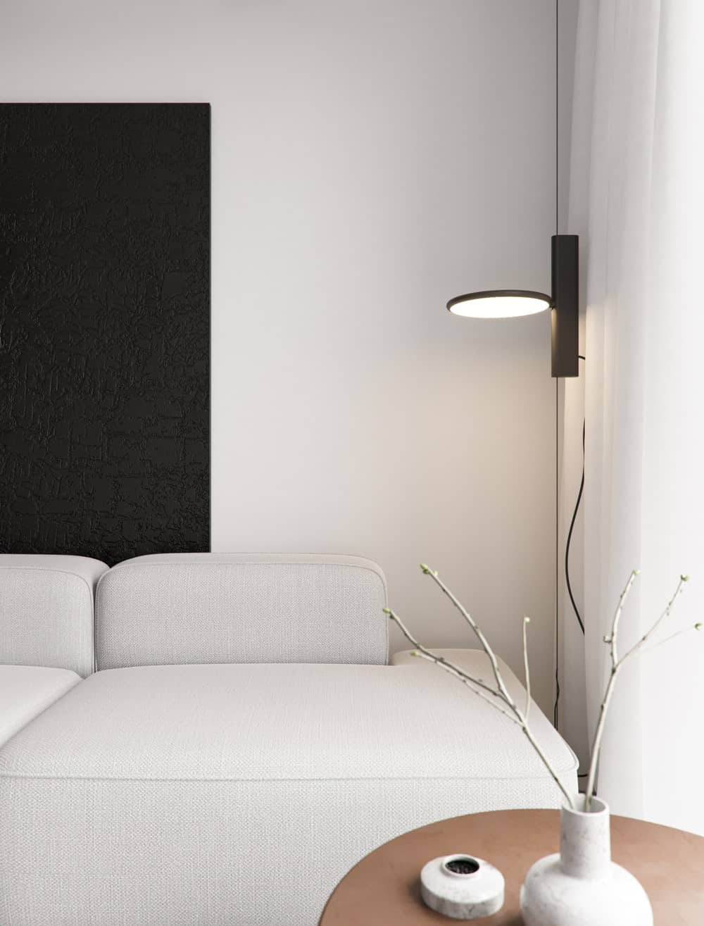 This is the other side of the sectional sofa that has a wall-mounted lamp and a small wooden coffee table.