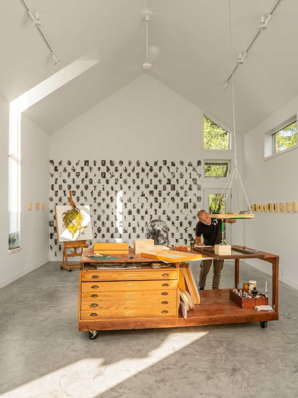 The large area is fitted with a large wooden work desk with wheels and built-in drawers.
