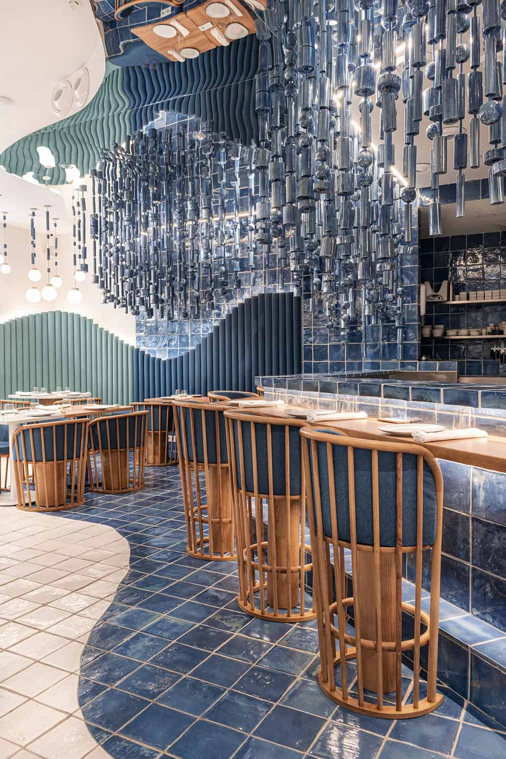 This is a close look at the flooring tiles by the bar with two tones on its flooring tiles mirroring the curved design of the booths.