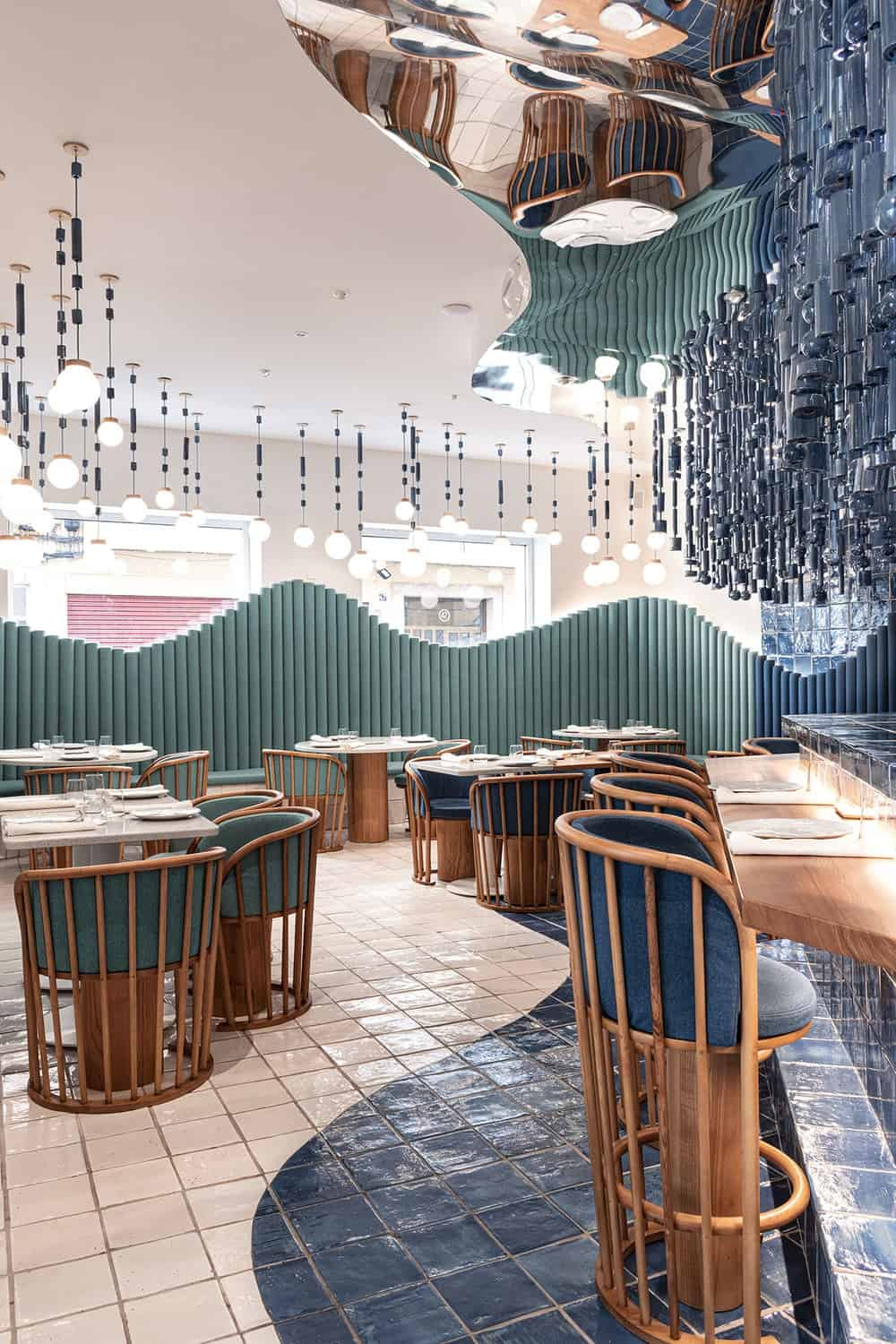 This view shows more of the curved patterns of the booths that matches with the flooring and ceiling patterns.